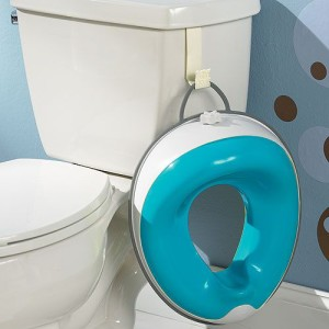 Potty seat hanging from toilet side