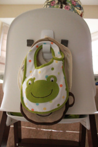 Bib hanging from high chair back